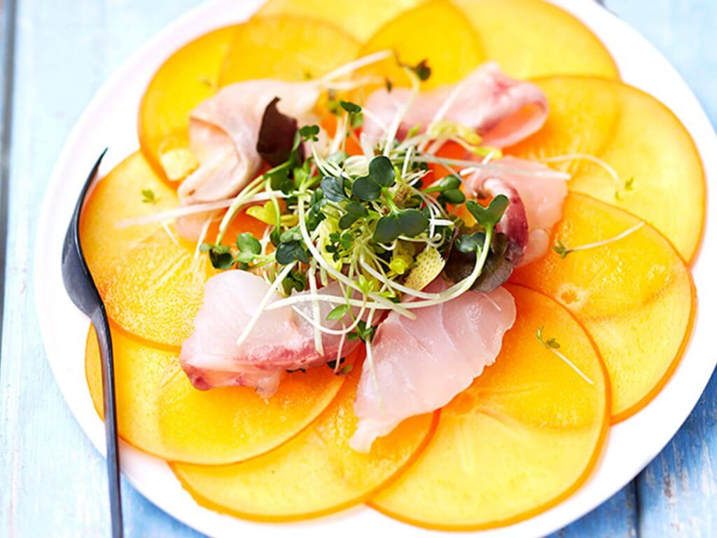 Persimon® kaki carpaccio with lemon & fleur de sel marinated sea bass